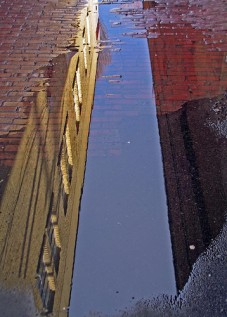 alley puddle reflection