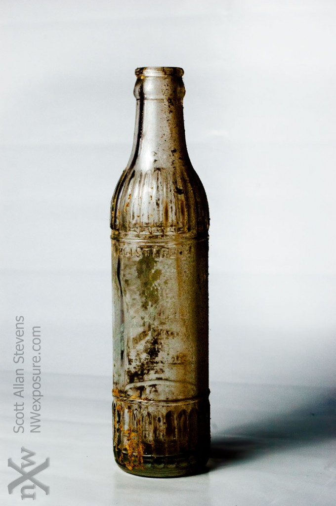 dirty antique glass bottle